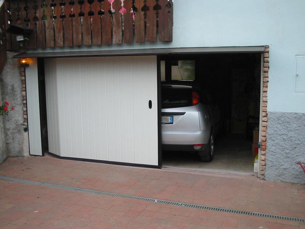 Bioelettrica portoni for 3 dimensioni del garage di stallo
